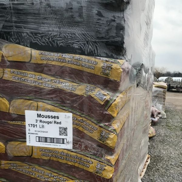 pallet of bags of red cedar mulch wrapped in plastic at the Bay Landscaping nursery
